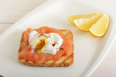 Poached egg with salmon on bread Royalty Free Stock Image