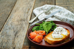 Poached egg with salmon and spinach Royalty Free Stock Photography
