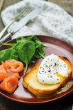 Poached egg with salmon and spinach Stock Photos