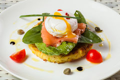 Poached egg with salmon, tomato, and baby spinach Stock Photography