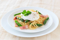 Poached egg on spaghetti Royalty Free Stock Photography