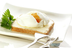 Poached egg on toast. Fork and knife Stock Photos