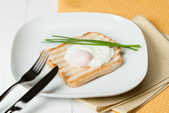Poached Egg On Toast With Chives. White Plate Royalty Free Stock Photo