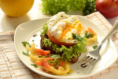 Poached egg on toast with vegetables Stock Image