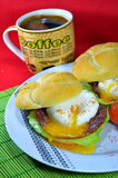 Poached egg on toasted bread. Poached egg on toasted English muffin Stock Photo