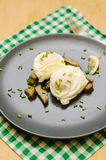 Poached eggs and artichokes Royalty Free Stock Photos