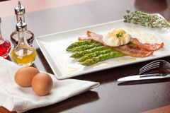 Poached eggs with bacon Stock Image