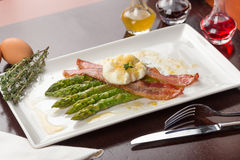 Poached eggs with bacon Stock Photos
