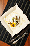 Poached eggs with baked asparagus Stock Images
