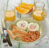 Poached eggs with beans Royalty Free Stock Photography