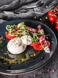 Poached eggs with fresh vegetable salad on grey plate background. Healthy vegetarian breakfast, clean eating, diet food, closeup. Poached eggs with fresh royalty free stock images
