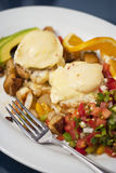 Poached eggs over Dungeness crab cakes Stock Images