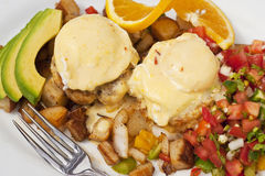 Poached eggs over Dungeness crab cakes Royalty Free Stock Images