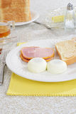 Poached eggs with Peameal bacon Royalty Free Stock Photos