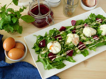Poached eggs on a salad Royalty Free Stock Image