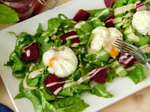 Poached eggs on a salad Royalty Free Stock Images