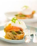 Poached eggs with salmon and asparagus Royalty Free Stock Image