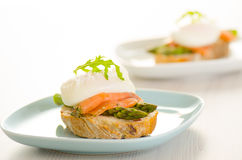 Poached eggs with salmon and asparagus Stock Images
