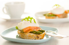 Poached eggs with salmon on toast Royalty Free Stock Photography