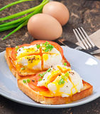 Poached eggs. On toast with tomato and pepper Royalty Free Stock Image