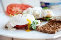 Poached eggs with watercress on toast Stock Photo