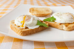 Poached eggs. On white plate Stock Images