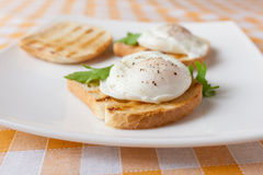 Poached eggs. On white plate Royalty Free Stock Photos