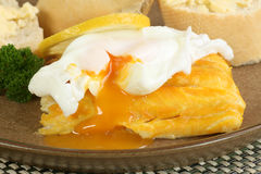 Poached haddock. Poached smoked haddock with egg and crusty bread Royalty Free Stock Photo