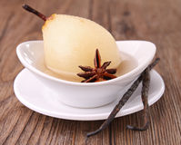 Poached pear. With vanilla, studio shot Stock Images