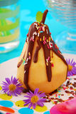 Poached pear with chocolate  for child Royalty Free Stock Photography