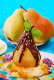 Poached pear with chocolate  for child Stock Images