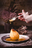 Poached pear with honey sauce - poire belle hellene in a rustic mood Stock Photo