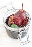 Poached pear in red wine Stock Photo