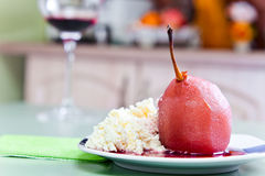 Poached pear with red wine sauce Royalty Free Stock Images