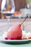 Poached pear with red wine sauce Stock Photography