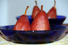 Poached pear in red wine Stock Photography