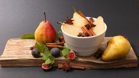 Poached pear and spice. Studio shot royalty free stock photo