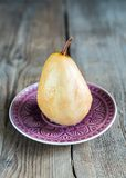 Poached pear in white wine Royalty Free Stock Images