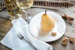 Poached pear in white wine Stock Images