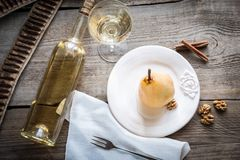 Poached pear in white wine Stock Photography
