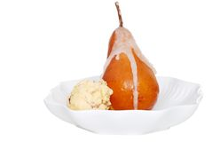 Poached pear with wine syrup and ice cream Stock Photography