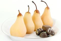 Poached Pears. A fresh tasting light dessert made with pears poached in water,sugar and a vanilla bean, serve plain or with chocolate stock image