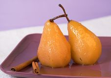 Poached pears. Two poached pears royalty free stock photo