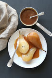 Poached pears with caramel Stock Images