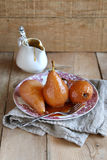 Poached pears with caramel sauce Stock Images