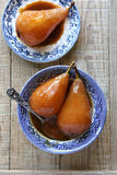 Poached pears with caramel sauce Royalty Free Stock Photo