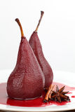 Poached pears in red wine. With cinnamon and anise. Shallow dof Royalty Free Stock Photos