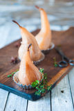 Poached pears with spices in syrup Stock Photo