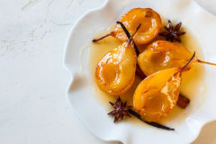 Poached pears with spices Stock Photo