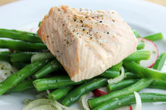 Poached Salmon. With a green bean and radish salad Royalty Free Stock Photos